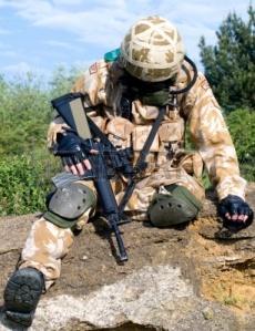 5313598-british-soldier-in-desert-uniform-sitting-wounded