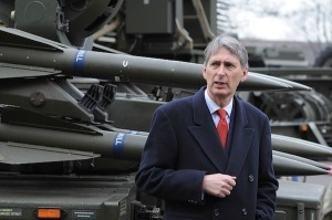 Defence Secretary Philip Hammond stands in front of a Rapier System ground-to-air missile launcher during a visit to RAF Waddington near Lincoln, England on February 29, 2012, to observe a London 2012 Olympic Games air security training exercise, codenamed Exercise Taurus Mountain 2. Aircraft including RAF Typhoon interceptors, RAF E-3D Sentry and RN Sea King surveillance aircraft, sniper-carrying RAF Puma and RN Lynx helicopters took part in the exercise. AFP PHOTO / ANDREW YATES (Photo credit should read ANDREW YATES/AFP/Getty Images)