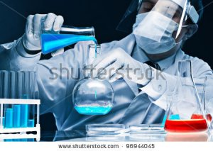 stock-photo-masked-male-scientist-mixing-bright-blue-substances-in-glassware-96944045