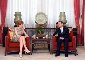 In this Wednesday, July 28, 2015 photo provided by China's Xinhua News Agency, First Minister of Scotland Nicola Sturgeon, left, talks with Chinese State Councilor Yang Jiechi in Beijing. (Xinhua/Xie Huanchi/Xinhua News Agency via AP) ) NO SALES