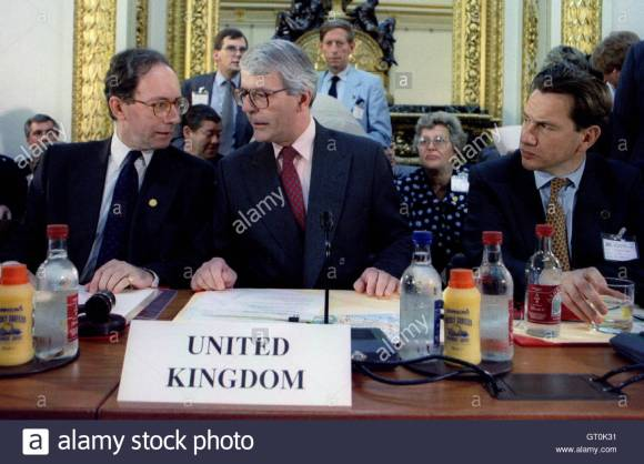 Prime Minister John Major (C) and Foreign Secretary Malcolm Rifkind (L) talk, watched by Defence Sec..